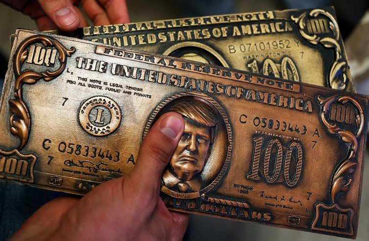 Illustration of Donald Trump on a $100 bill