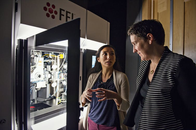 Melanie Ohi with grad student Amanda Erwin outside the cryo-electron microscope.
