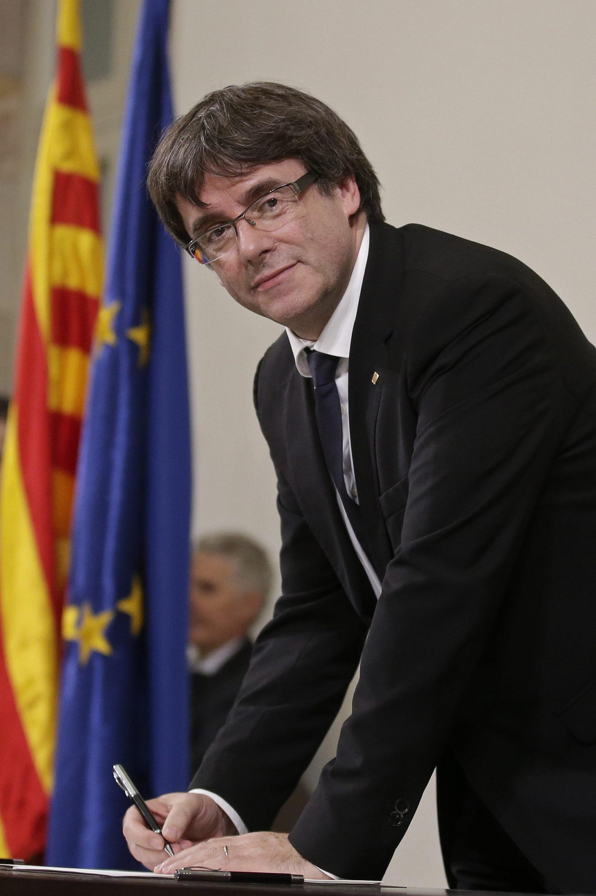 Carles Puigdemont signing an independence declaration