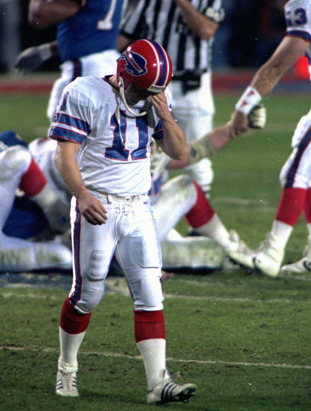 Buffalo Bills kicker Scott Norwood walks off the field after missing what would have been the game-winning field goal against the New York Giants in Super Bowl XXV. Chris O'Meara/AP Photo