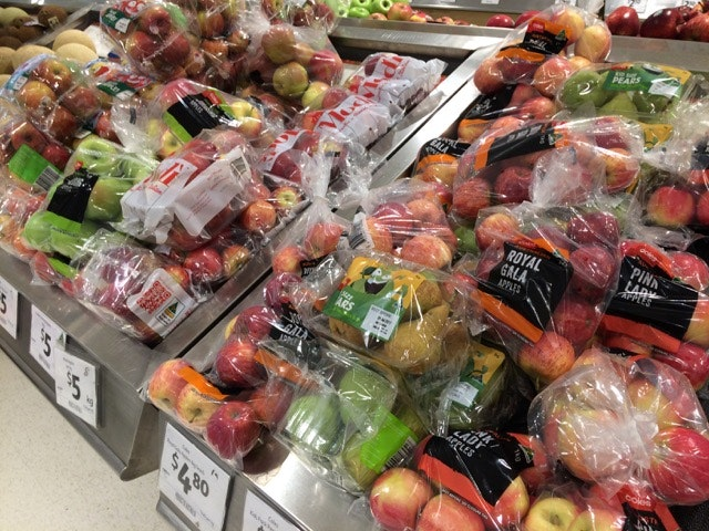 Picture of rows of fruit all wrapped in plastic