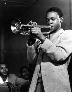 A young Hugh Masekela in the 1950s blowing his horn. Johncom