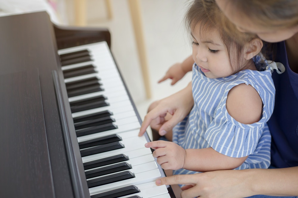 Picture of a young child at a piano