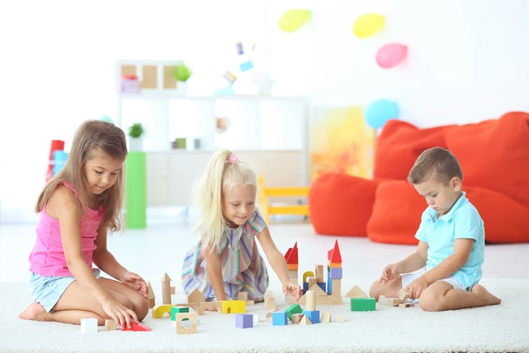 Kids learn to play and work together when using blocks.