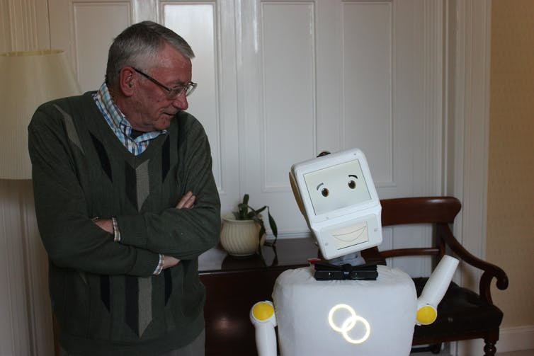 Test user, Tony, with Stevie, the prototype robot.
