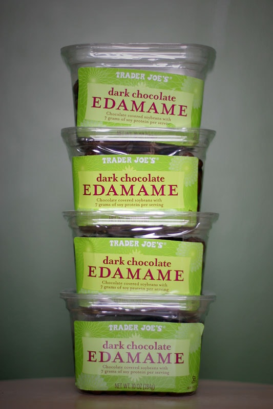 Containers of dark chocolate edamame
