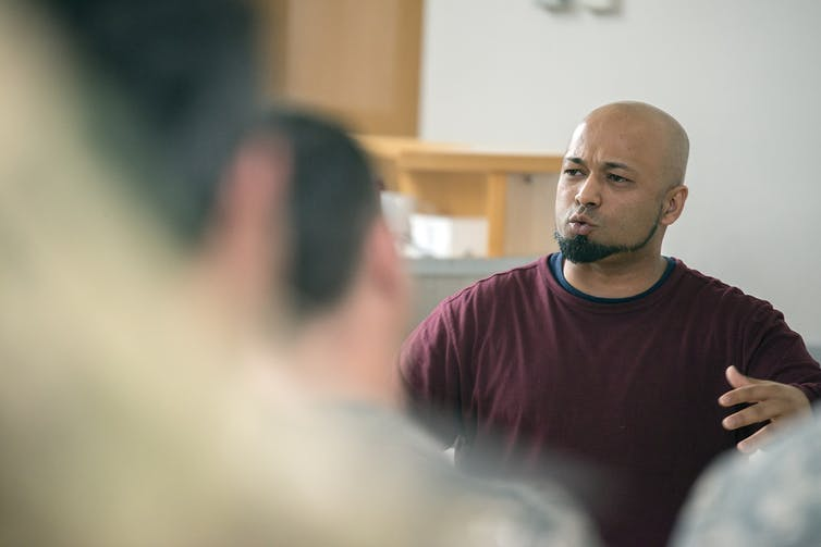 Mubin Shaikh, a Toronto-born de-radicalization expert, speaks during a counter-terrorism event in Germany in May 2015. U.S. Army