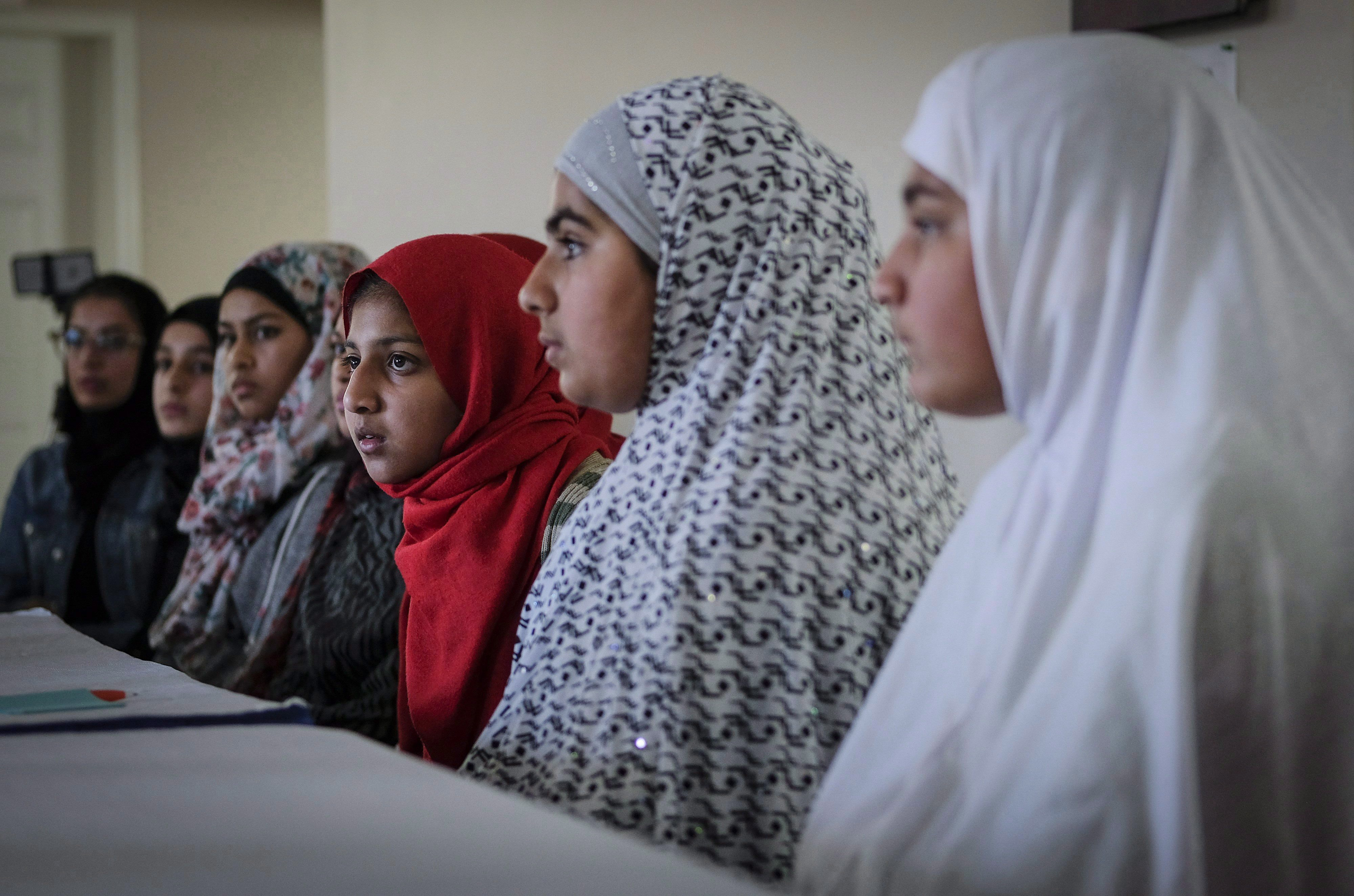 Young girls listen to Imam Syed Soharwardy, founder of Muslims Against Terrorism and the Islamic Supreme Council of Canada, speak about anti-radicalization strategies at a mosque in Calgary in October 2017. THE CANADIAN PRESS/Jeff McIntosh