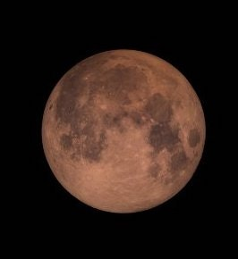 A super blood moon tinted red by scattered light. GSFC, CC BY