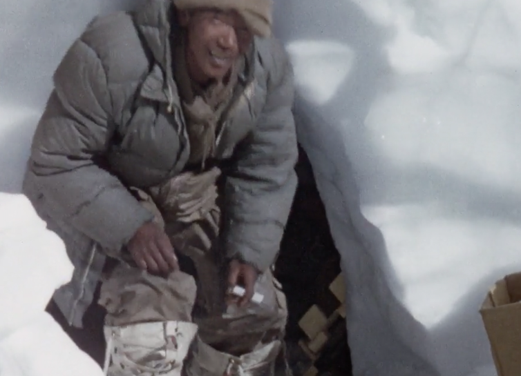 At home in a snow hole. Still from Kangchenjunga 1955. Courtesy: British Film Institute/Royal Geographical Society