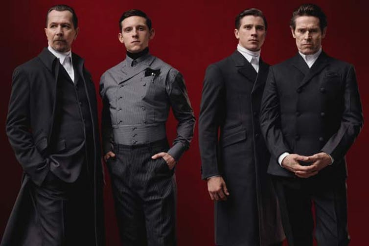 Distinguished cast: actors Gary Oldman, Garrett Hedlund, Jamie Bell and Willem Dafoe model Prada's Fall 2012 collection (Photo: Prada)