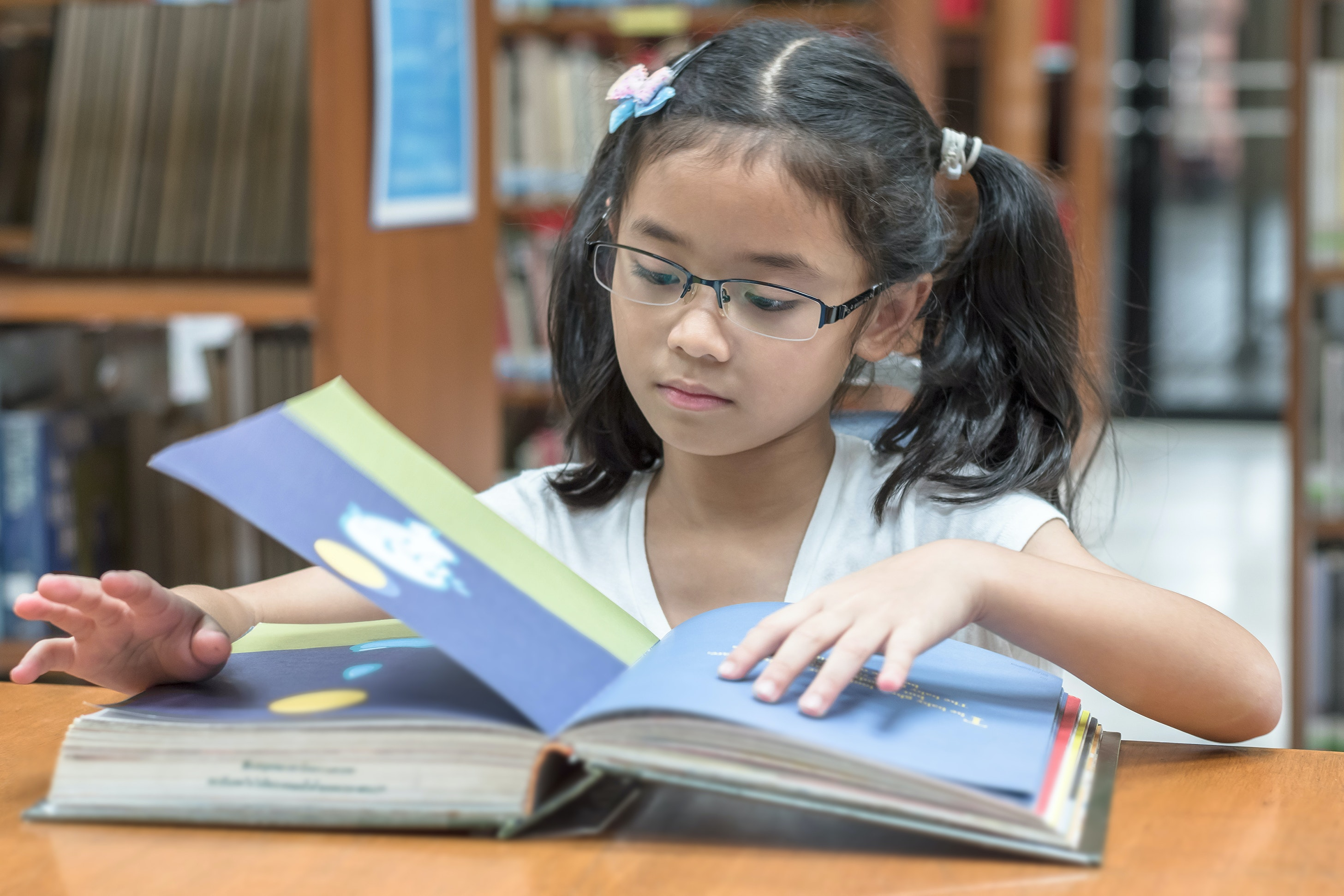 photo of a child reading a book