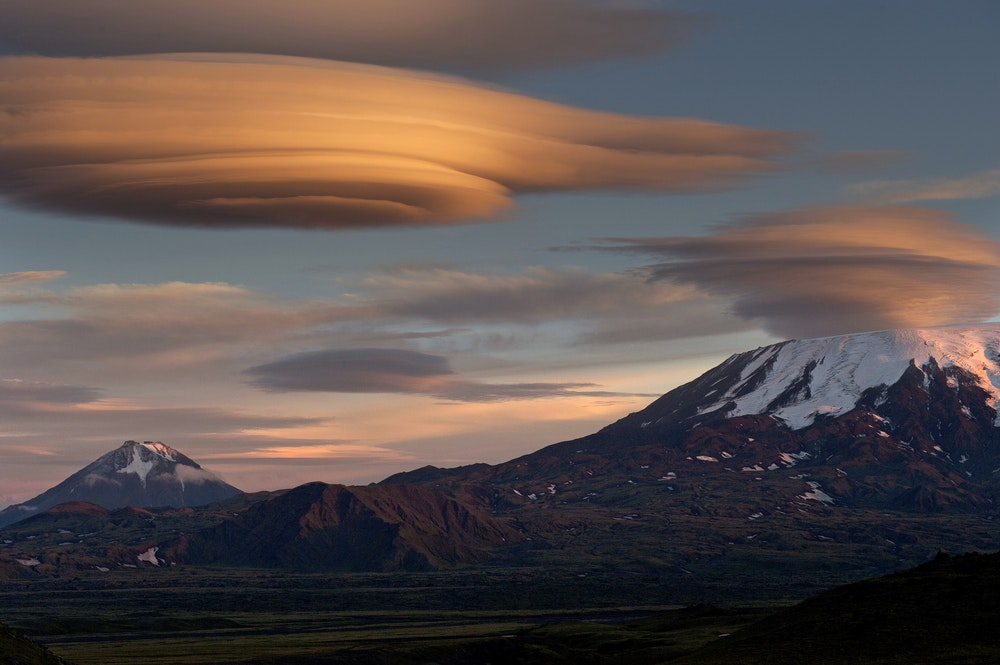Lenticular clouds form over mountains.  (Shutterstock)