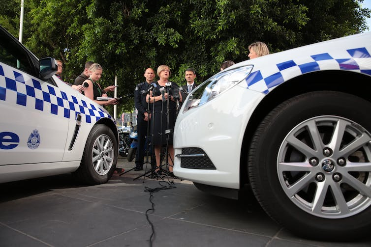 Victoria's minister for police, Lisa Neville, answers questions about allegations of police misconduct. Photo: AAP/Stefan Postles