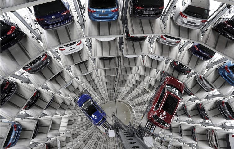Volkswagen cars are lifted inside a delivery tower of the company in Wolfsburg, Germany in March 2017.