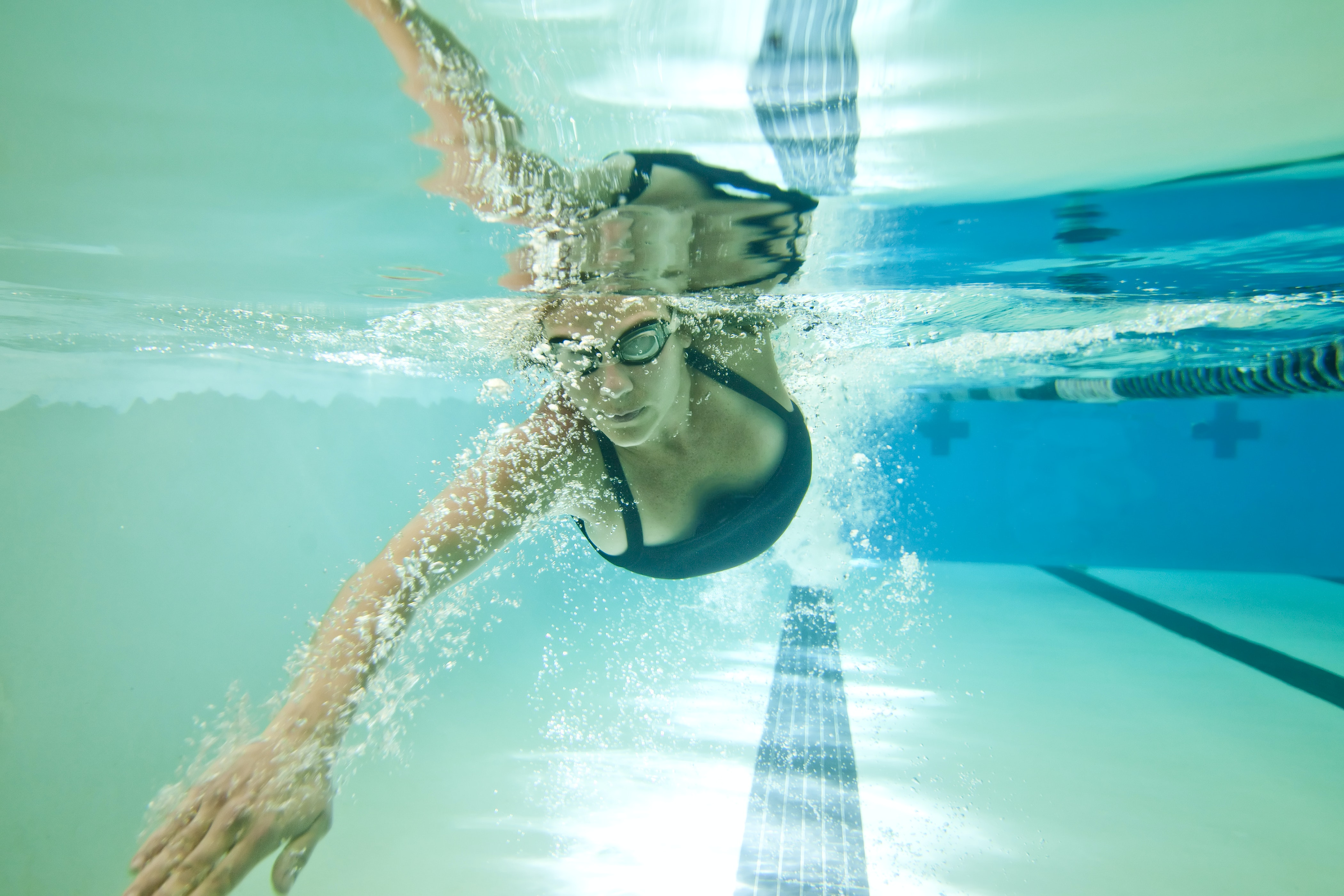 Exercises such as swimming can help strengthen the core. from shutterstock.com