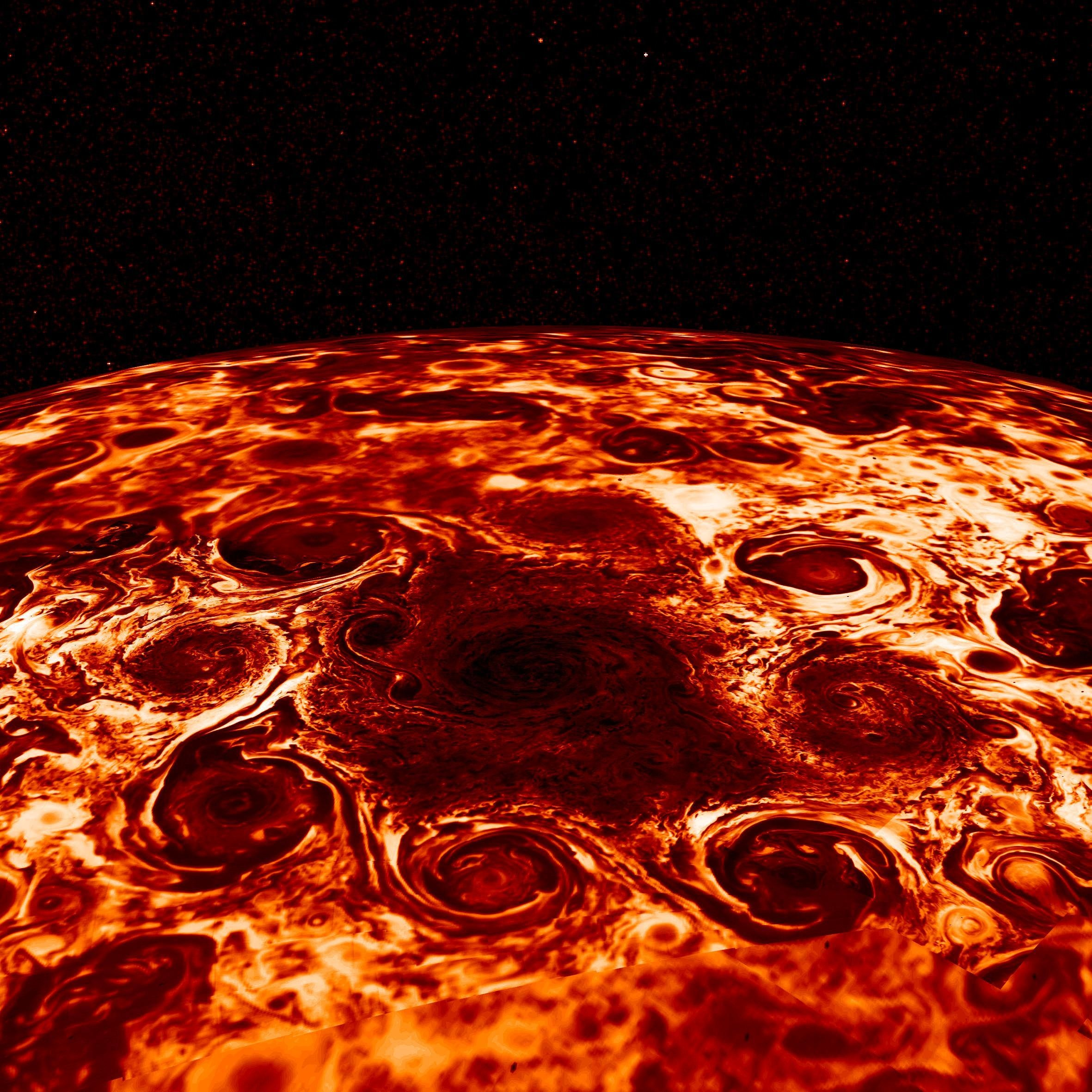 Jupiter's northern cyclones in infrared, which captures the radiating heat. In this original image, darker regions are colder and cloudier, while brighter regions are relatively cloud-free, allowing us to look deeper. NASA/JPL-Caltech/SwRI/ASI/INAF/JIRAM