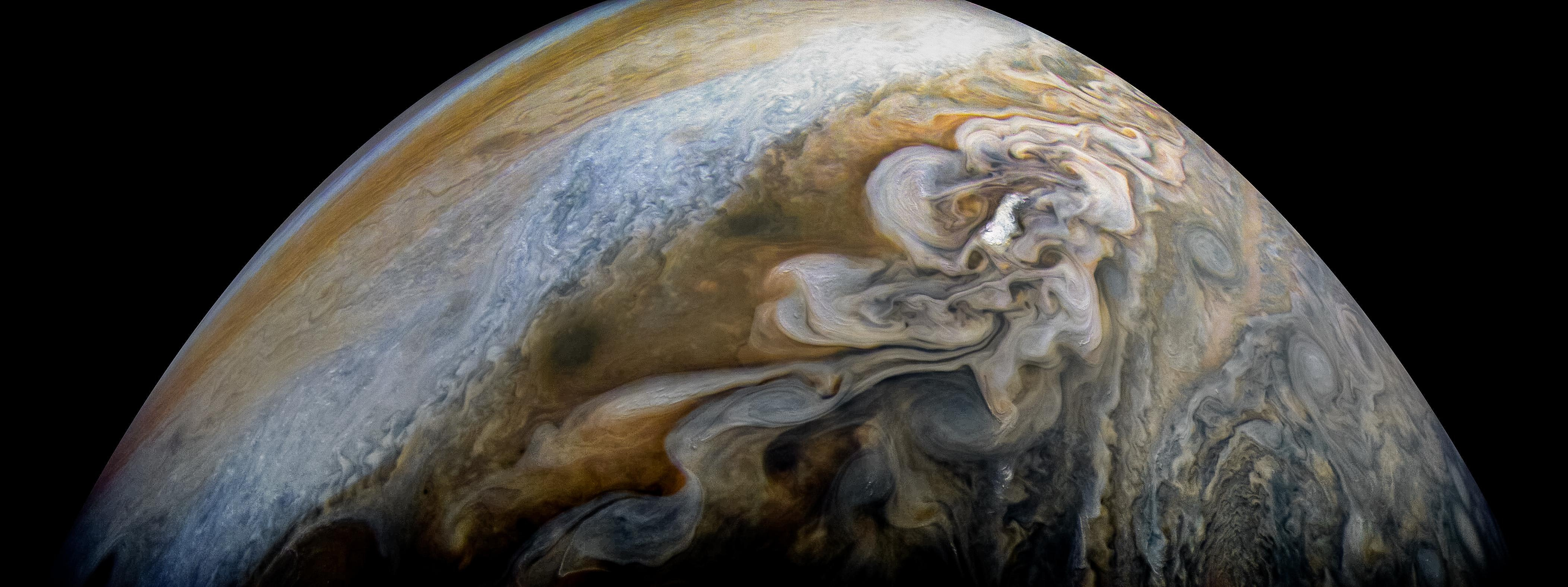 Swirling cloud belts of Jupiter's northern hemisphere. NASA/JPL-Caltech/SwRI/MSSS/Kevin M Gill