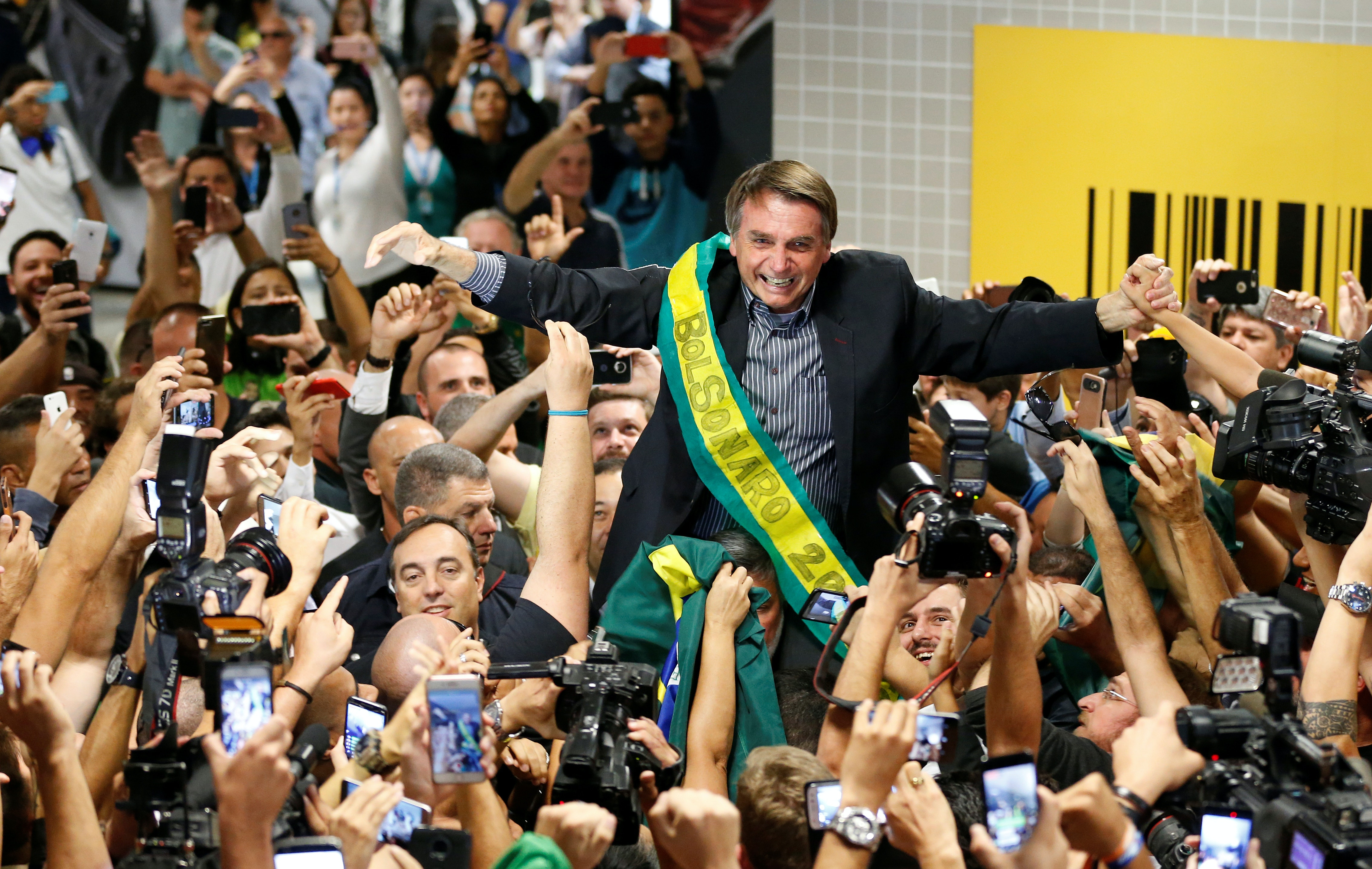 Brazilian candidate still crushing his rivals from jail