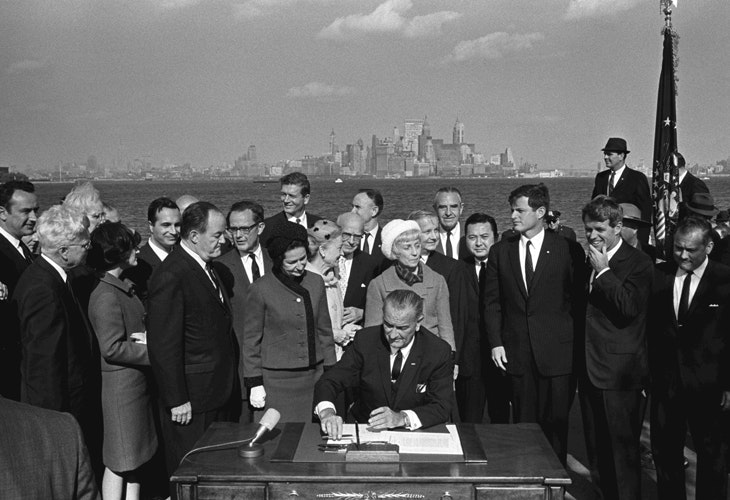 President Lyndon B. Johnson signs the Immigration and Nationality Act at Ellis Island. LBJ Library photo by Yoichi Okamoto