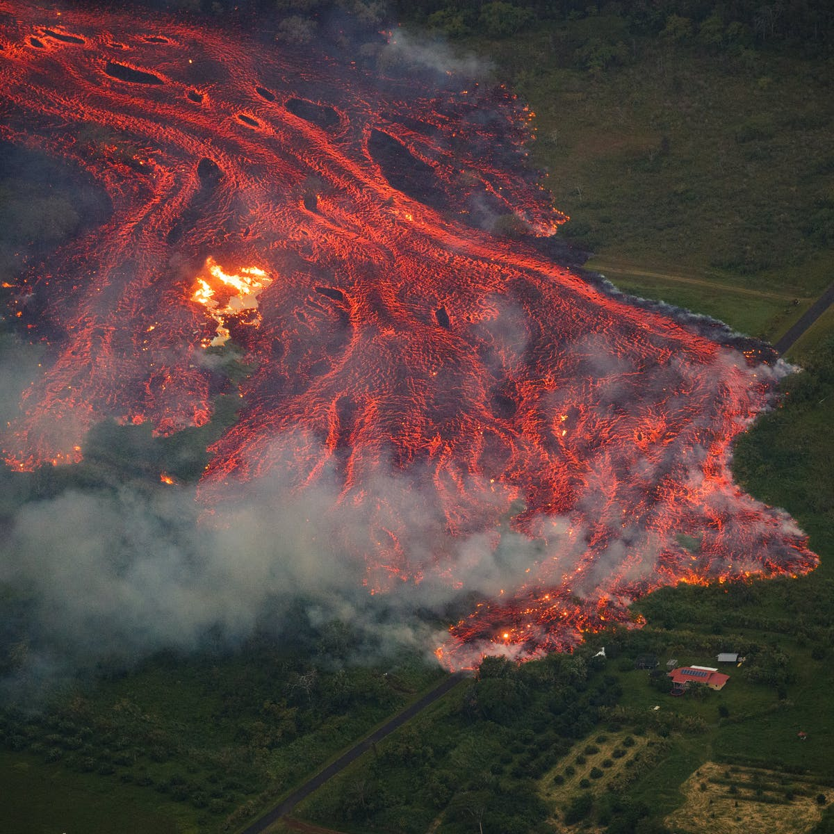 Lava in Hawai'i is reaching the ocean, creating new land but also