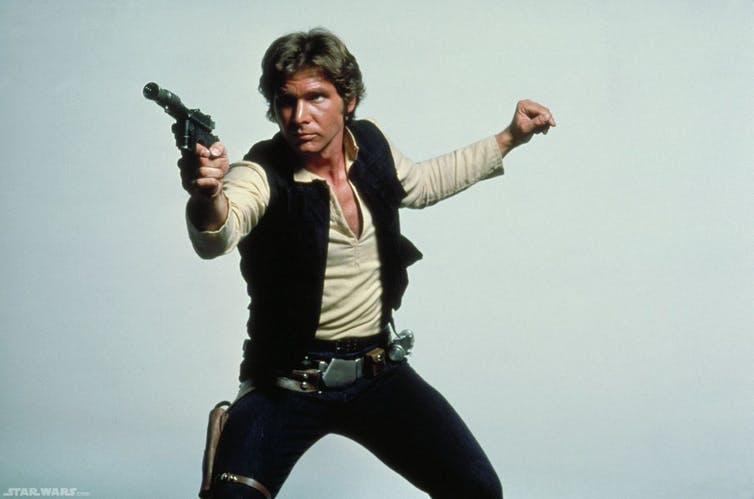 Harrison Ford as Han Solo with his blaster in the old Star Wars triology.