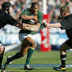 1ec3ba507d6 South African rugby player Ashwin Willemse (in green jersey) playing  against New Zealand s All Blacks in 2003.