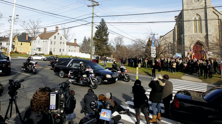 Funeral services took place for Benjamin Andrew Wheeler, one of the students killed in the Sandy Hook Elementary School shooting, while a hearse with another shooting victim drives by