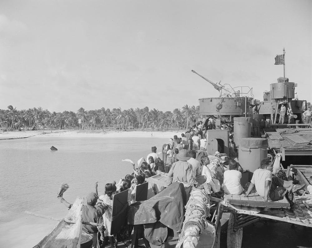 In this march 14 1946 file photo native people wave farewell to their bikini atoll home ap photo clarence hamm file