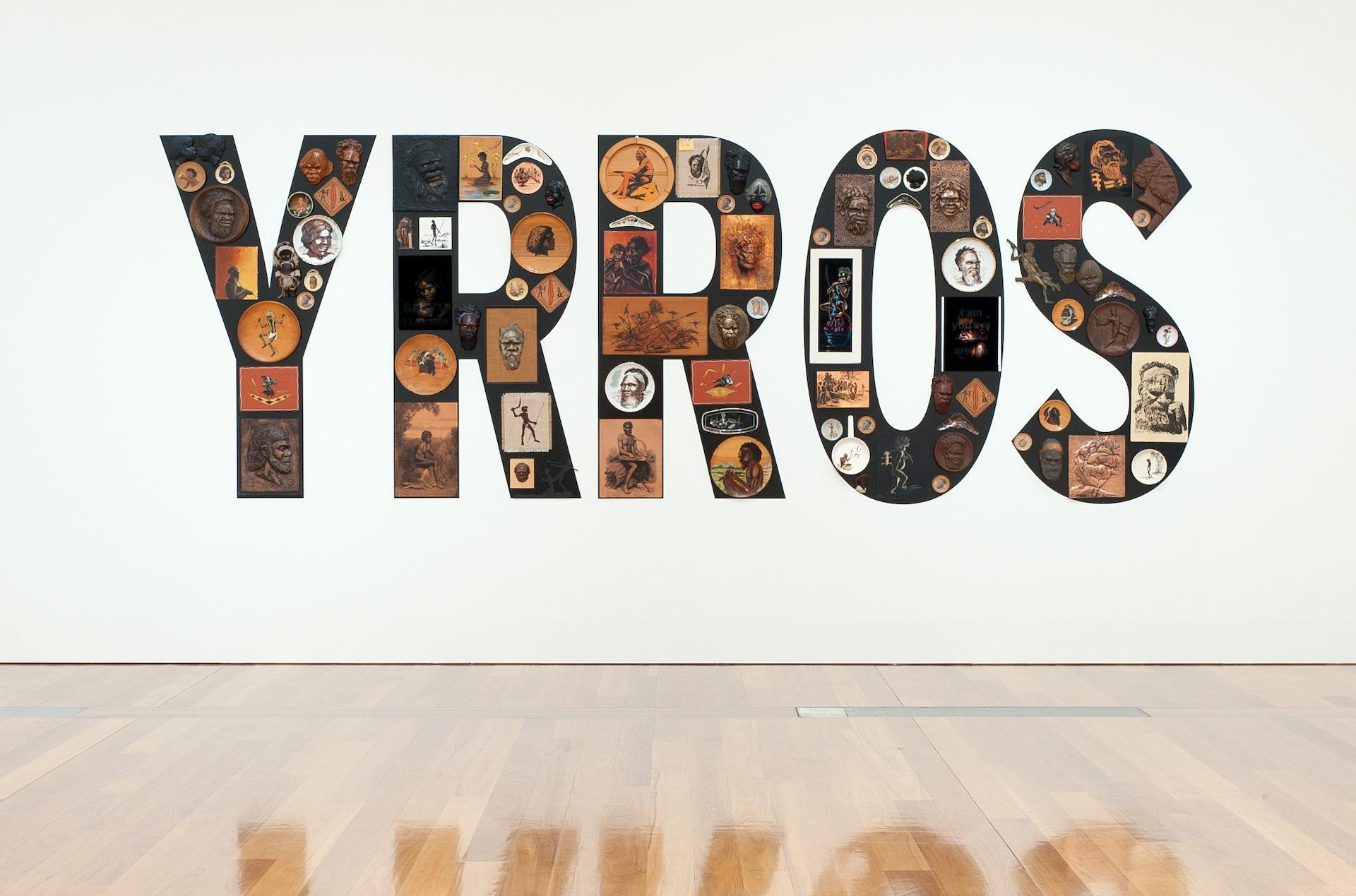 Tony Albert. Girramay/Yidinji/Kuku Yalanji peoples Australia Qld/NSW b.1981 Sorry 2008 Found kitsch objects applied to vinyl letters 99 objects: 200 x 510 x 10cm (installed)