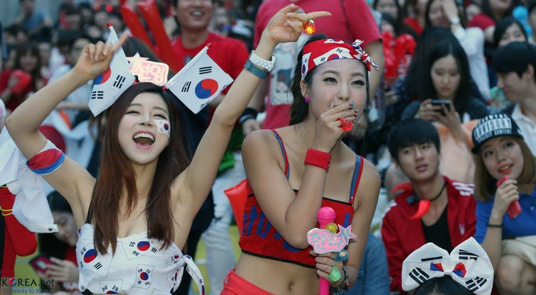 7213f8731cd South Korean fans cheering for their team in Seoul during the 2014 World Cup.  Korean Culture and Information Service Wikimedia Commons