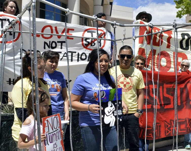 Immigrant rights advocates speak against Trump's policies in New Mexico.