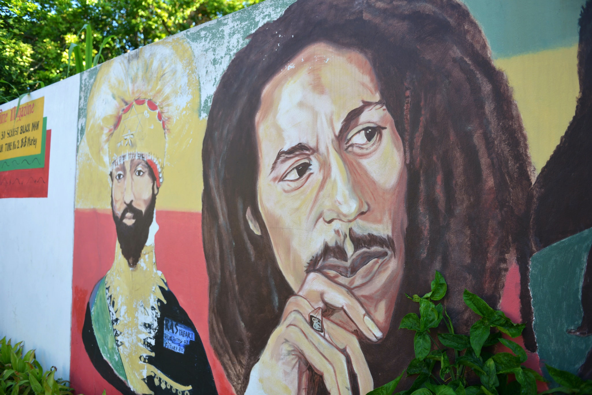 A mural depicting reggae music icon Bob Marley, right, and former Ethiopia's Emperor Haile Selassie decorate a wall in the yard of Marley's Kingston home, in Jamaica. AP Photo/ David McFadden