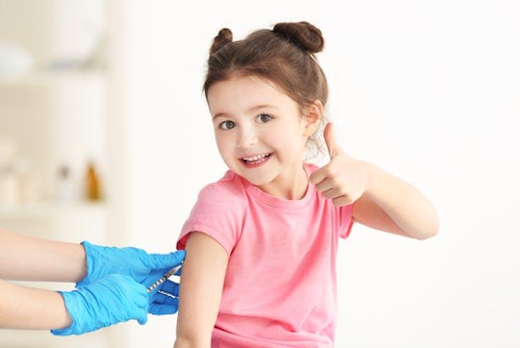 happy-girl-receiving-vaccination