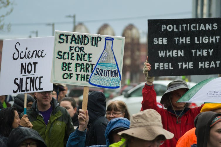 Image of Protesters challenge the suppression of climate change research by President Trump. www.shutterstock.com