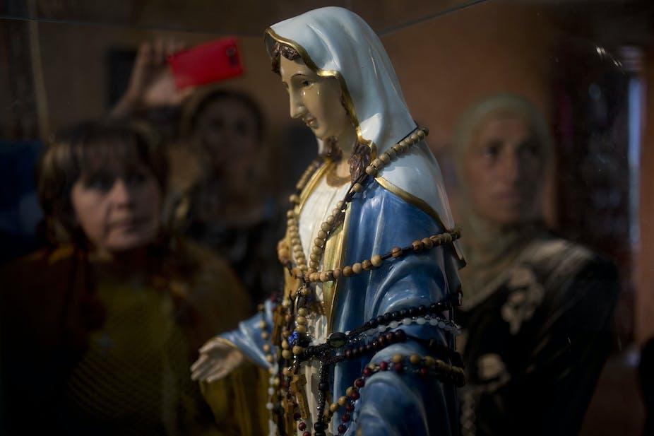 What is behind belief in weeping Virgin Mary statues