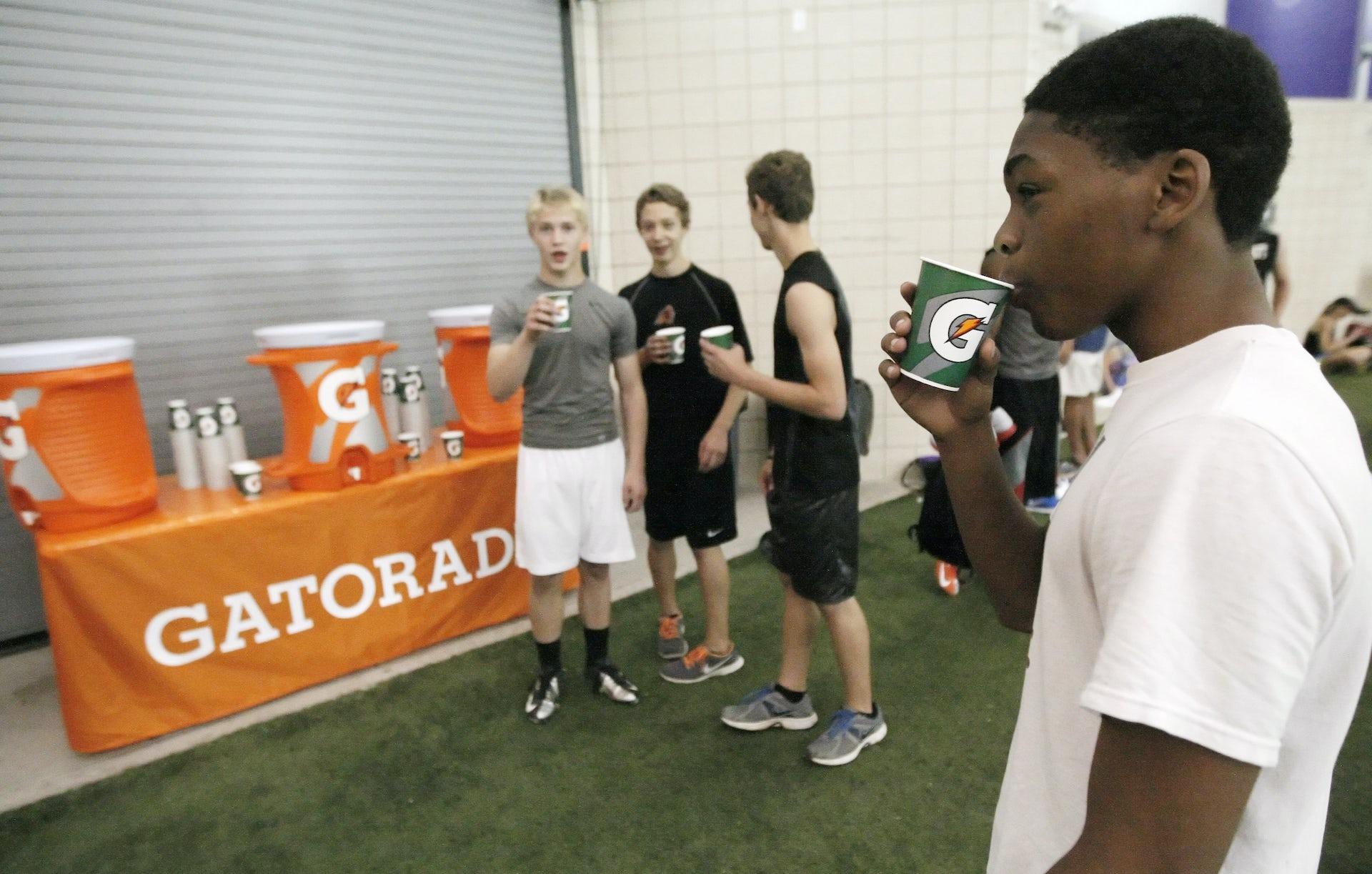 Young athletes drinking Gatorade