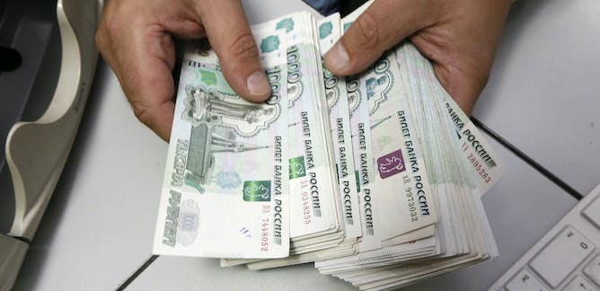 An Employee Counts Russian Ruble Banknotes