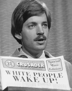 David Duke holds up a copy of the Klan newspaper, The Crusader, in this 1977 photograph. AP Photo
