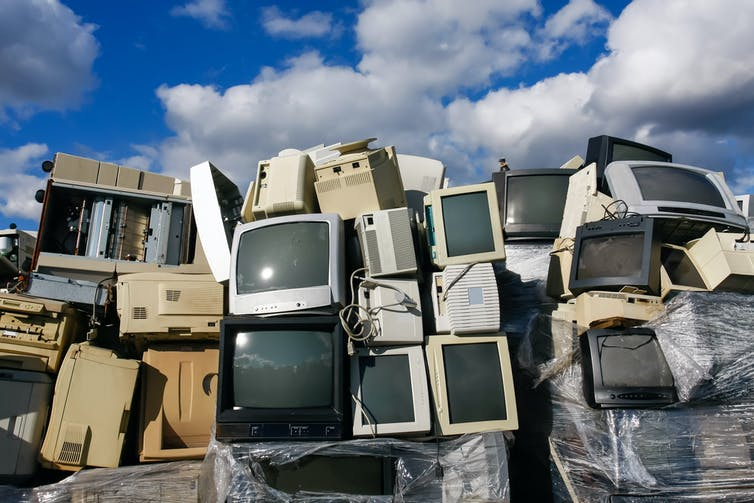 Old television sets at a landfill site