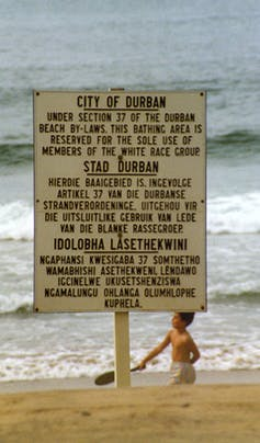 Signage in Durban reflecting apartheid values, 1989