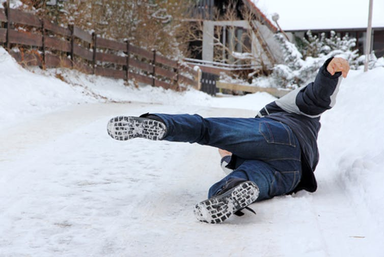 man falling in snow