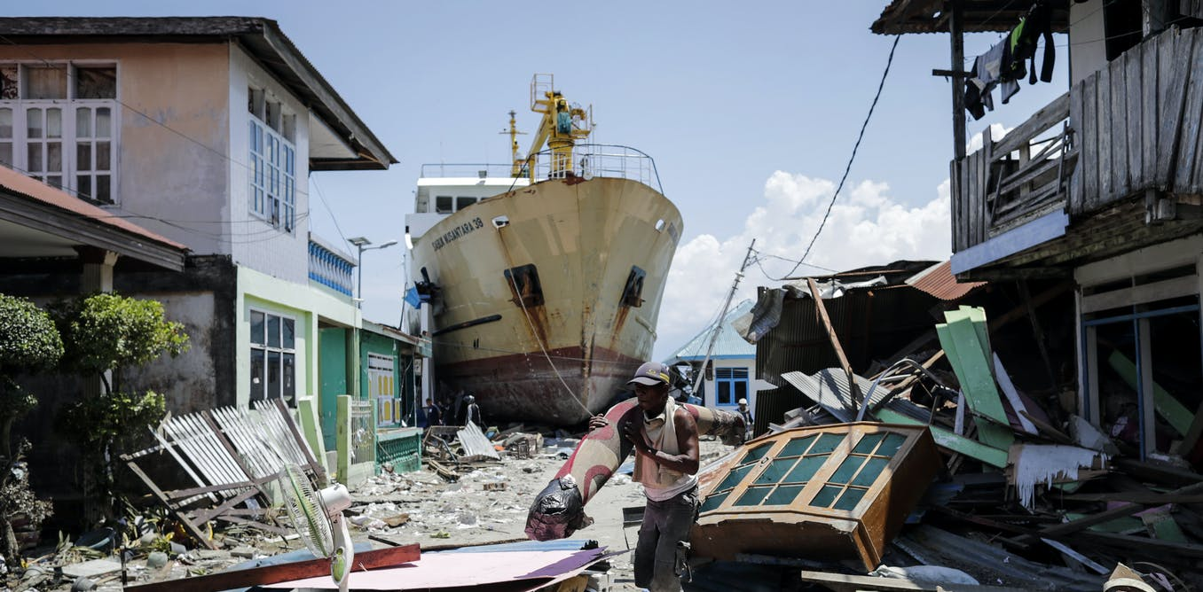 Tsunami damage, Indonesia 2004. Image by Mast Irham/EPA via The Conversation