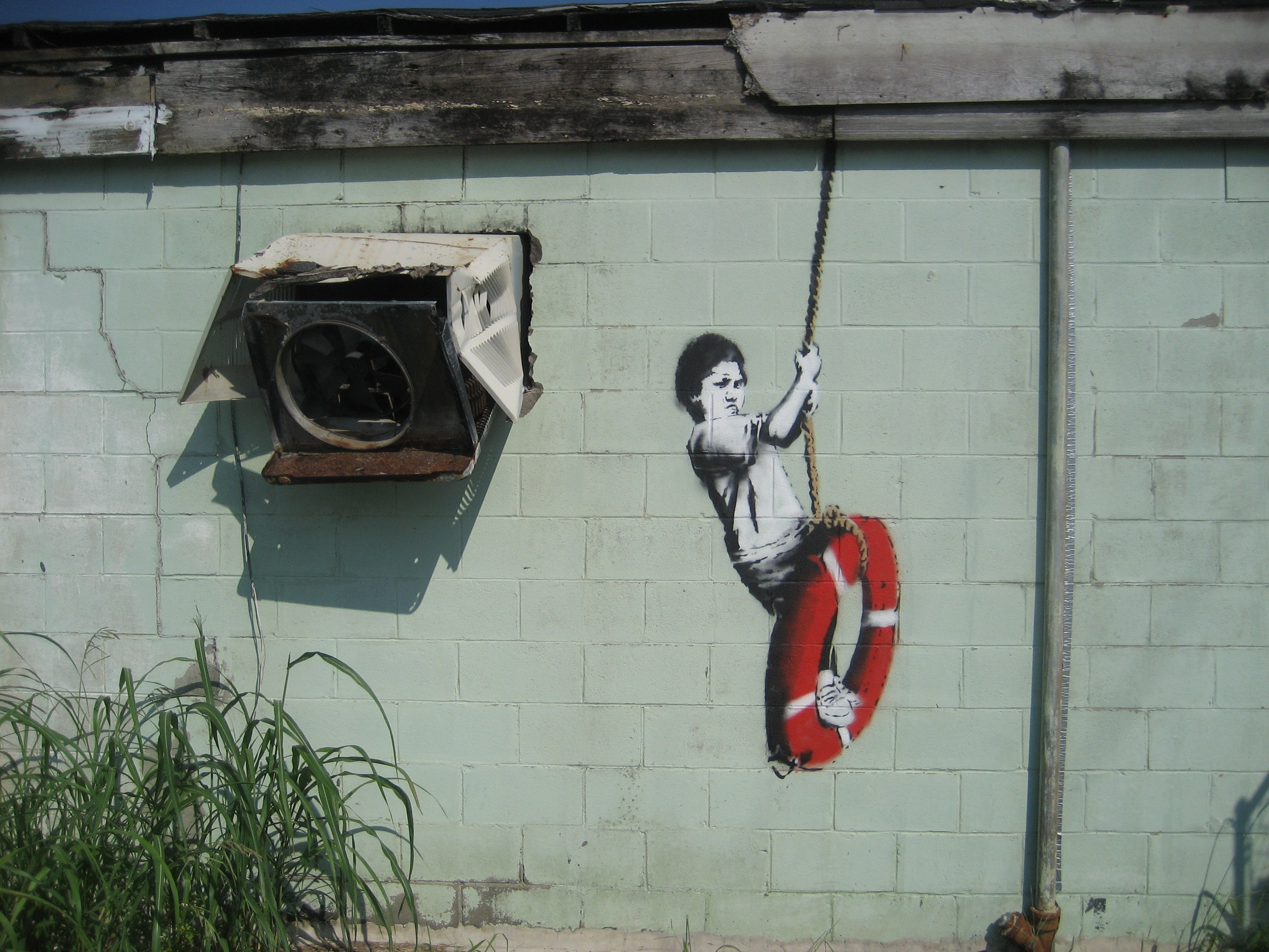 Banksy Swinger in New Orleans. Photo credit: Infrogmation of New Orleans, CC BY-SA