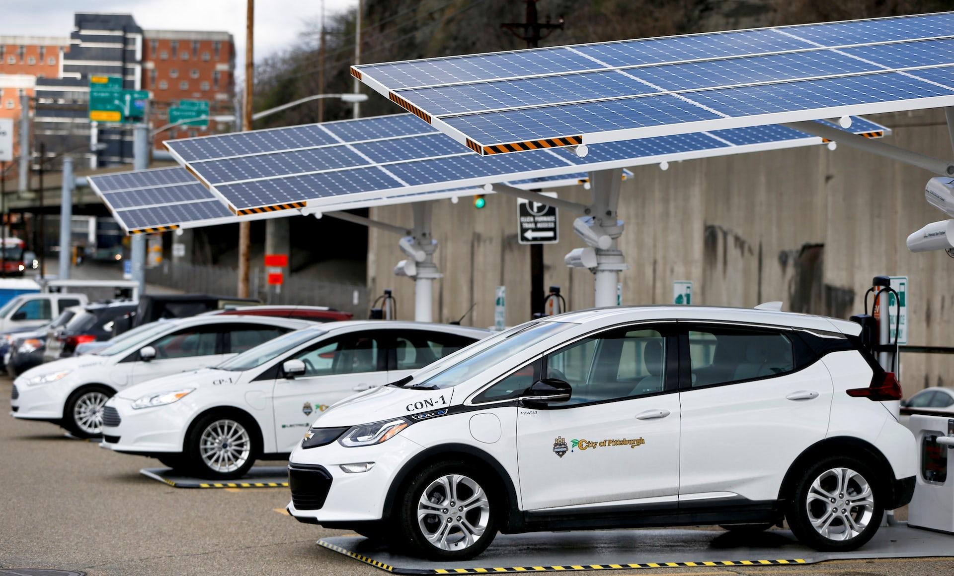vehicles at solar powered charging station
