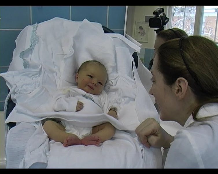 smiling-baby-with-nurse
