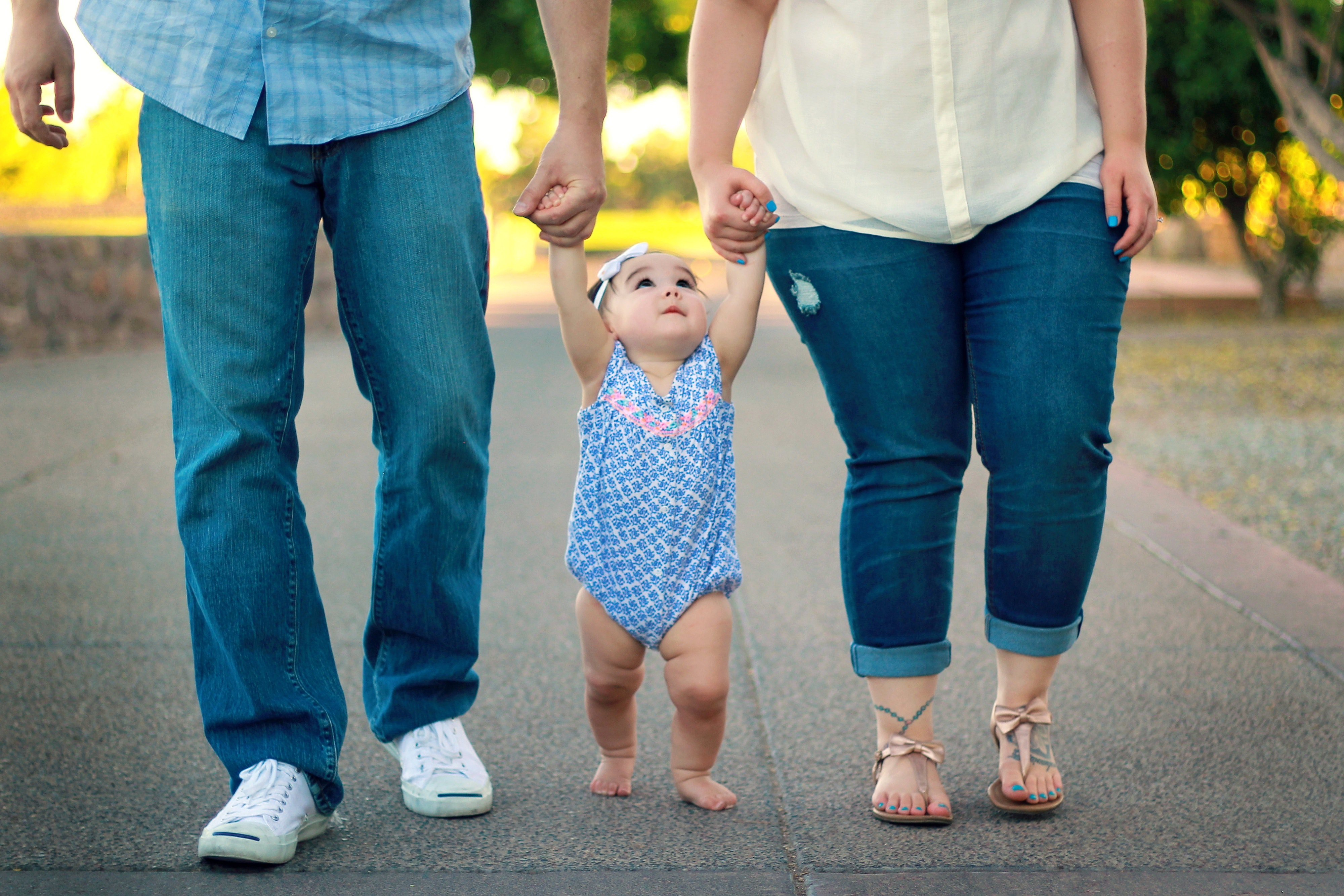 mom-and-dad-walking-with-baby