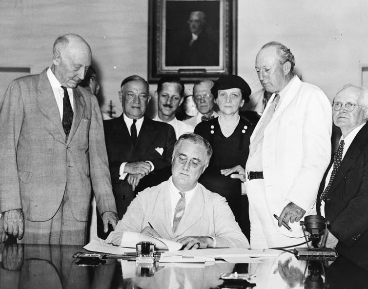 President Roosevelt signing the New Deal