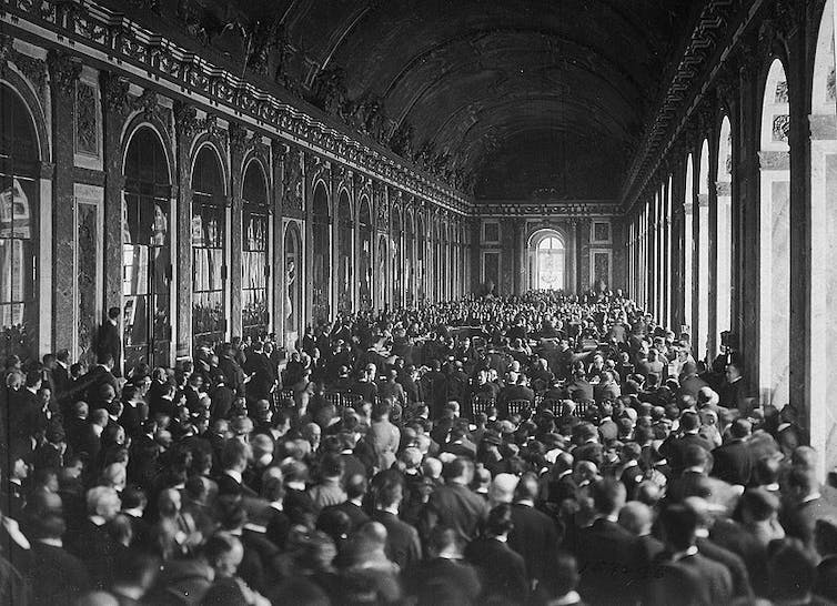 The delegations signing the Treaty of Versailles in the Hall of Mirrors. US National Archives
