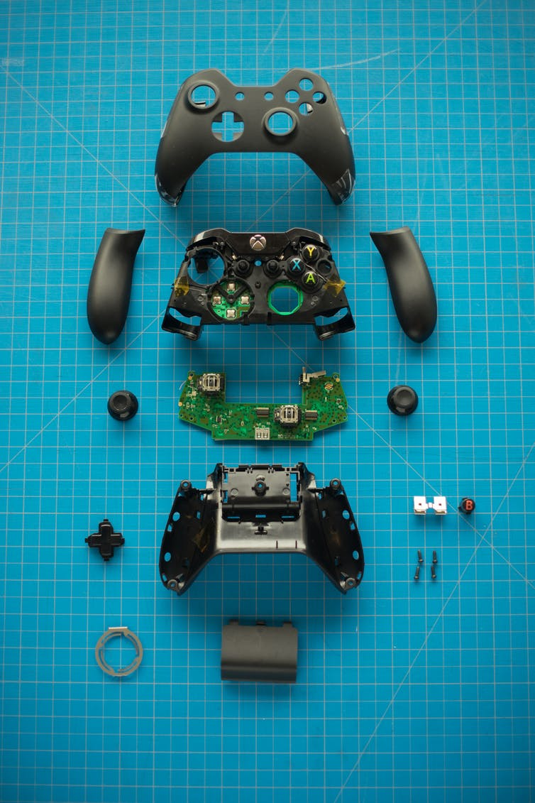 A gaming controller that has been pulled apart